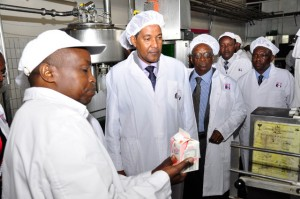 Mr. Nderitu, Dandora Factory Manager explains packaging process to Dr. Ismail